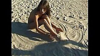 Beautiful new faced legal age teenager plays at the beach naked