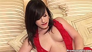 Busty in red teasing on daybed